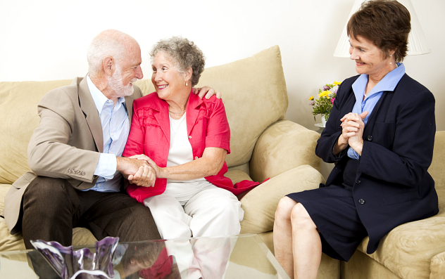 Elderly couple and their assistant